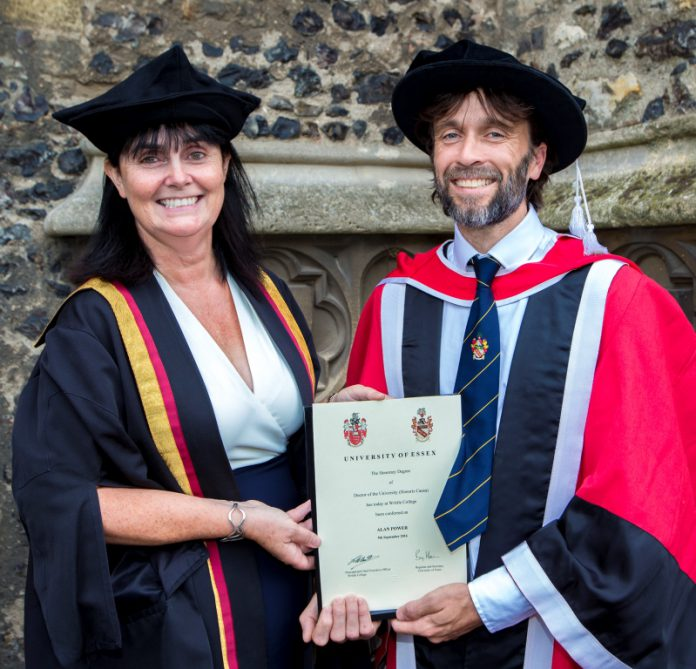 Chair of the board of governors, Julia Smith, presents Alan Power with his honorary doctorate
